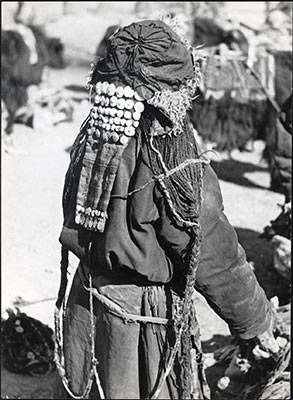 Horpa woman with hat and textile hair extension