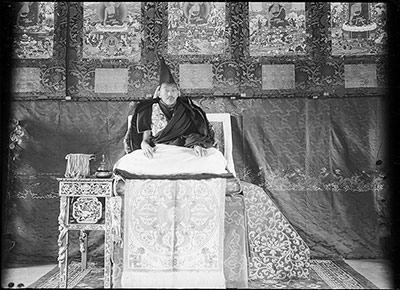 The Thirteenth Dalai Lama on  throne in Norbu Lingka