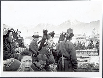 Men, women and children on a roof in Lhasa