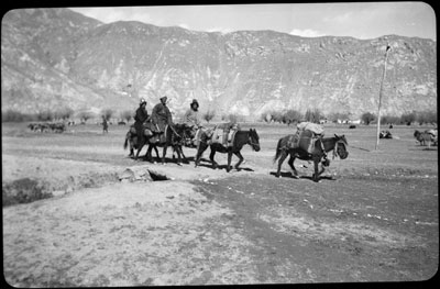 A family travelling along a road outside Lhasa