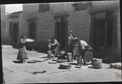 Grinding corn at house in Lhasa