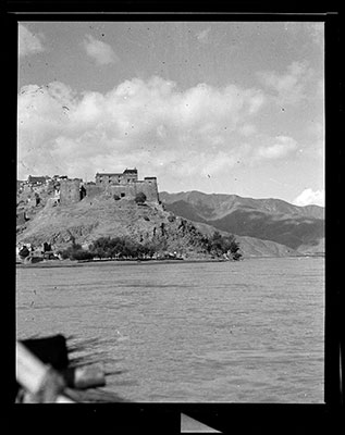 Fortress of Gongkhar Dzong with river flowing in front