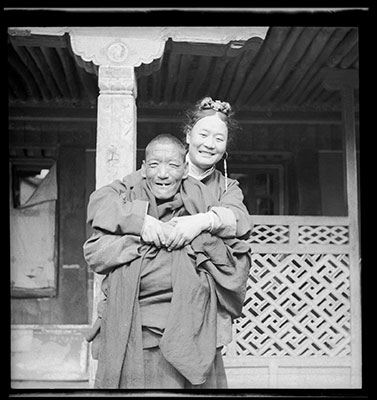 Gonpo Tsering Phunkhang with arms around a monk