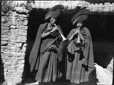Two monks blowing short horns, Gyantse