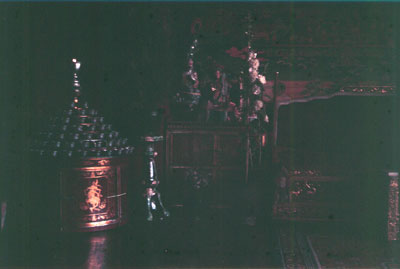 Norbu Lingka interior with large stand of butter lamps