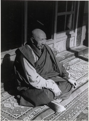 Khenchung Lobsang Jungme seated on a carpet